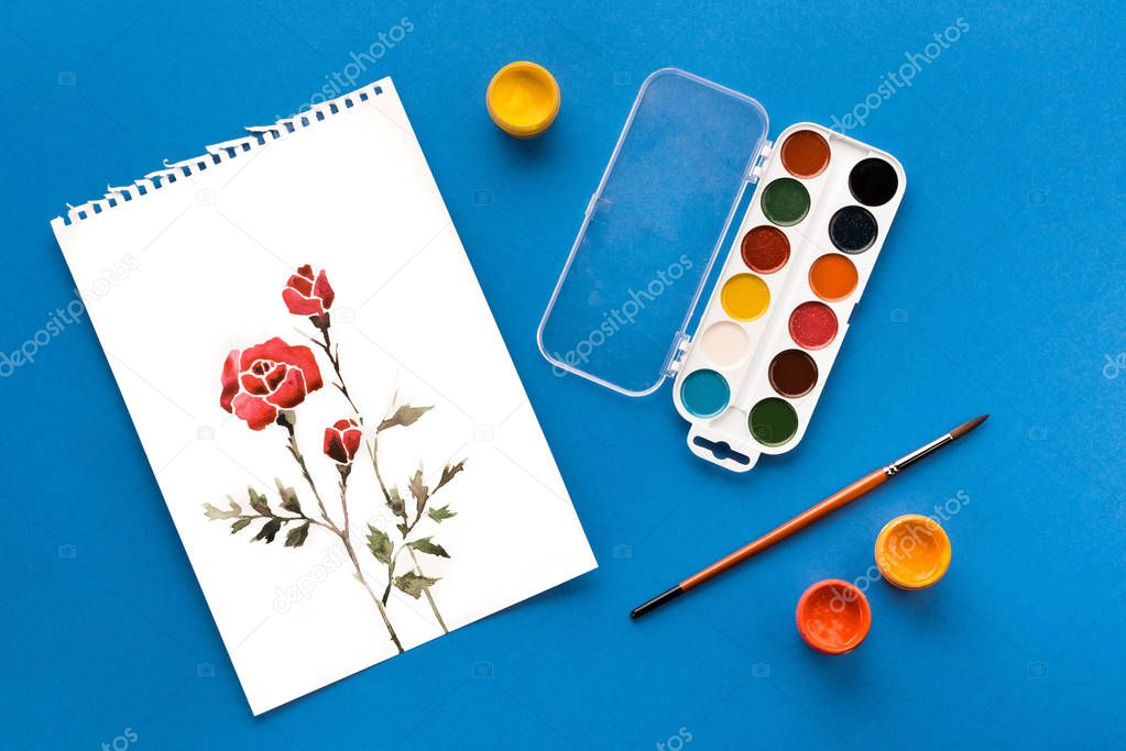 drawing, paints and brush