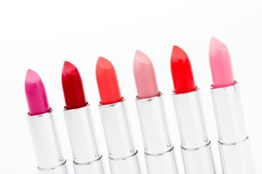 Set of fashionable lipsticks in red and pink colors isolated on white stock vector