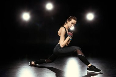 sportswoman doing stretching exercises
