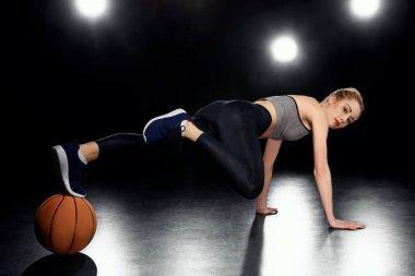 sportswoman in plank position