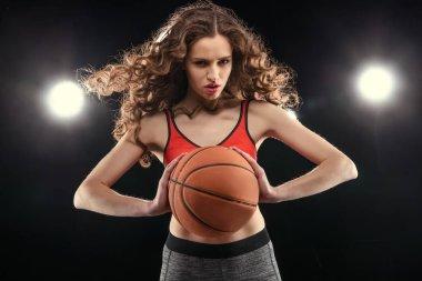 Sporty woman with basketball ball