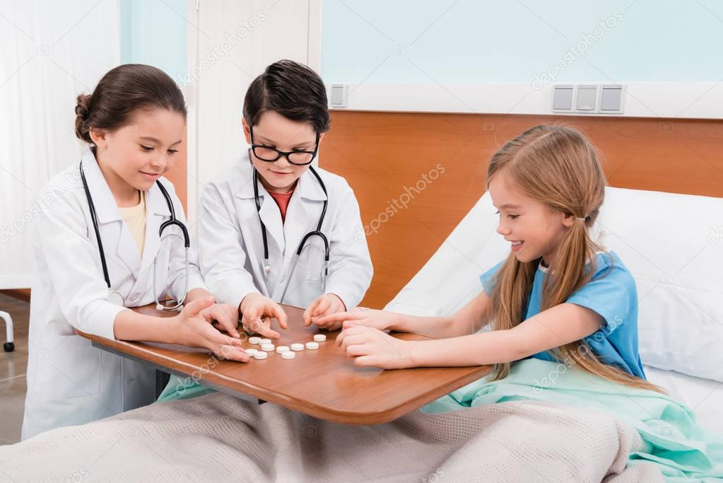 Kids playing doctors and patient