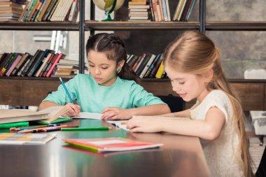 Schoolchildren studying together