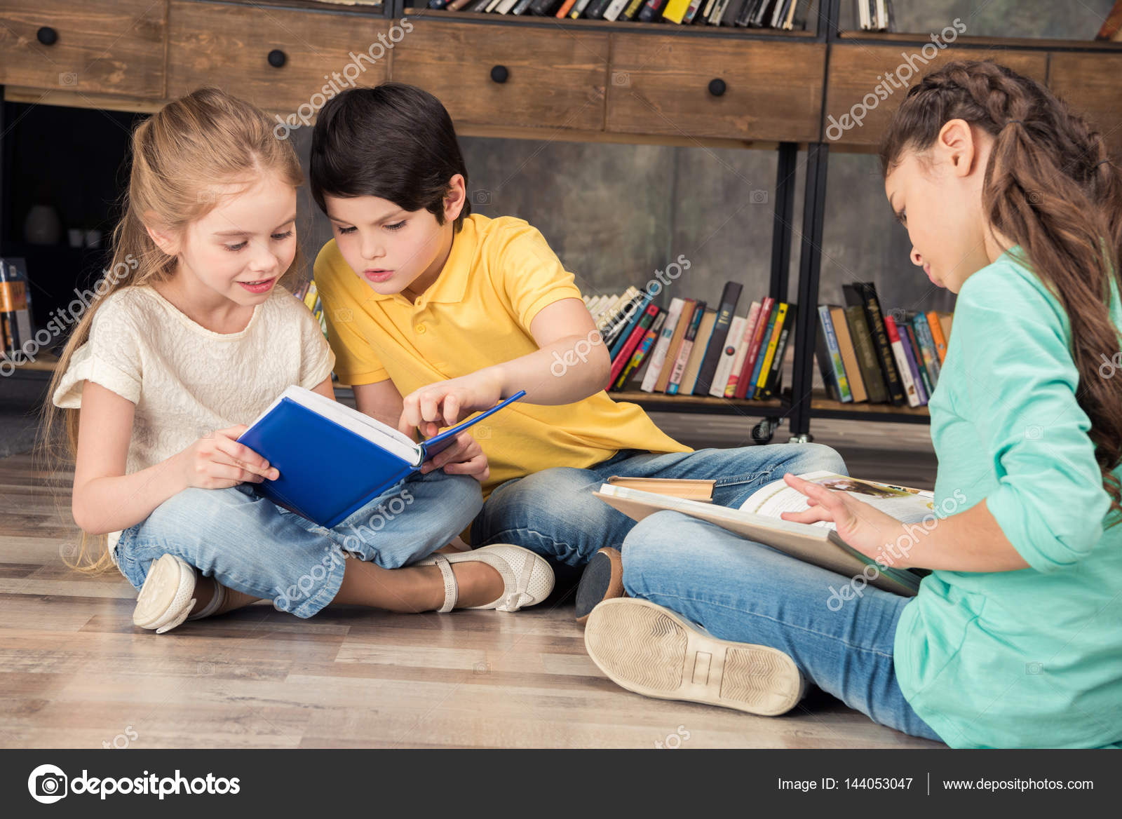 classmates reading books stock photo zaramuzafarova 144053047