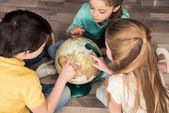 Fotografie children with globe in library