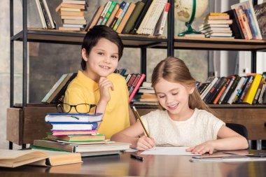 Schoolchildren studying in library