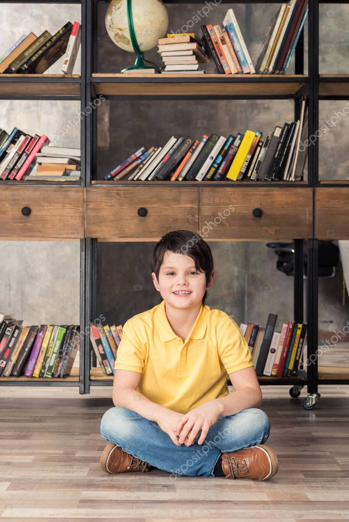 smiling boy in library