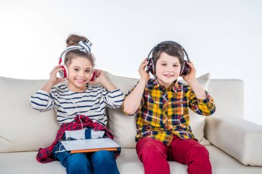 Children with headphones and digital tablet
