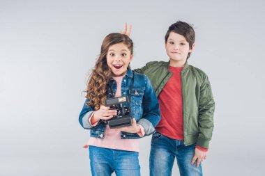 Children with retro camera