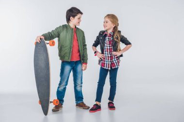 Boy and girl with skateboard