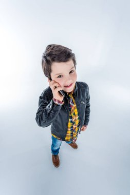 Boy talking on smartphone