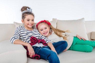 girls sitting on sofa