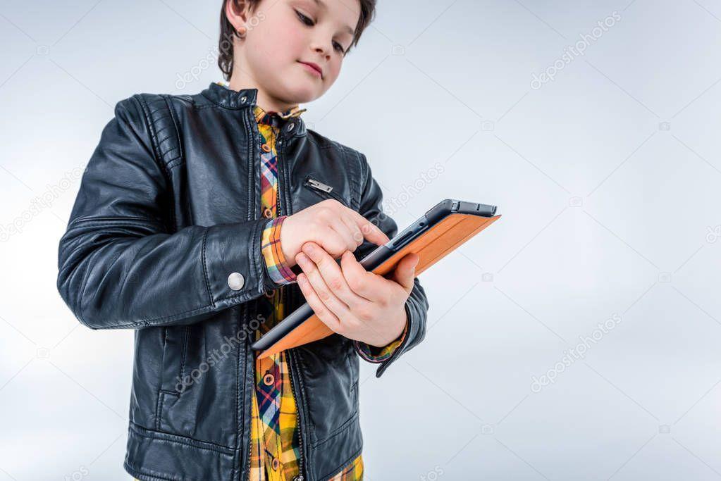boy using digital tablet