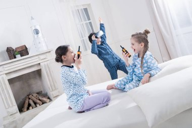 Kids in pajamas playing