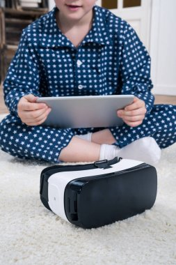 boy with VR and digital tablet