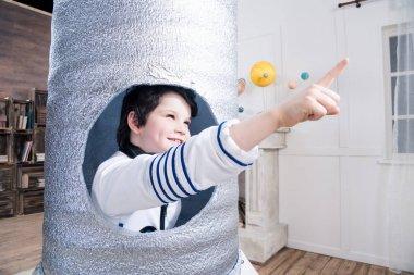 boy in toy rocket