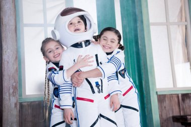 children in astronaut costumes
