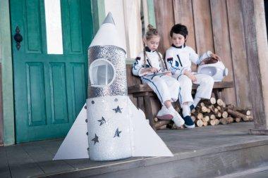 toy rocket and children astronauts
