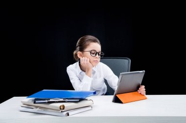 Girl pretending to be businesswoman