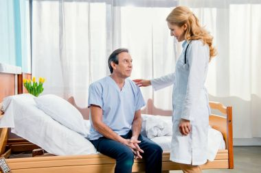 middle aged patient and doctor