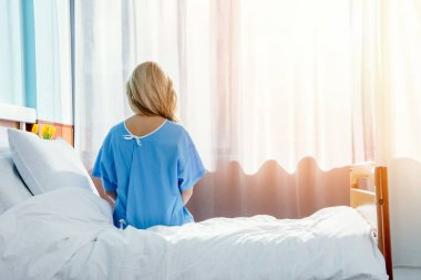 woman sitting on hospital bed