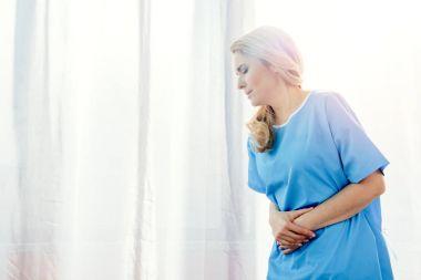 woman feeling stomach pain