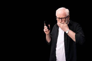 senior man talking on smartphone