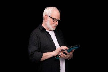 senior man using tablet