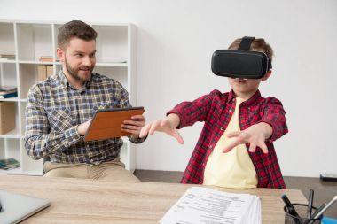 boy wearing virtual reality glasses