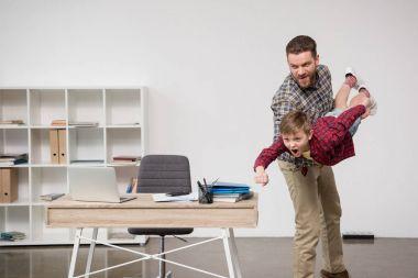man having fun with son