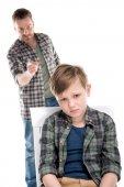 Fotografie Vater und Sohn mit Konflikt
