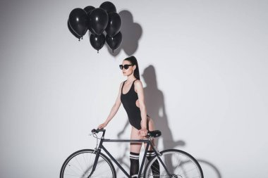 Woman in bodysuit with bicycle