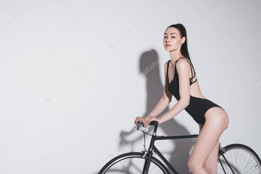 Woman in bodysuit on bicycle