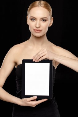 Woman showing tablet