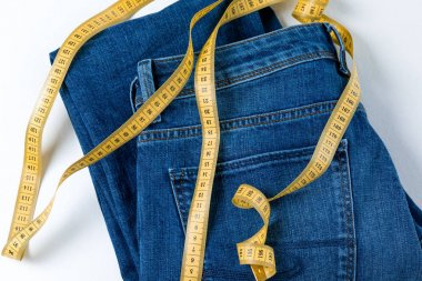 Jeans and measuring tape