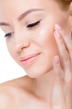 woman with foundation cream on face