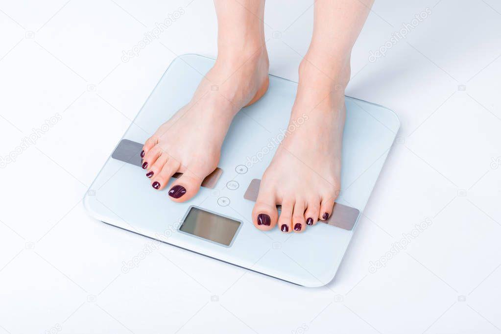 Woman on digital scales