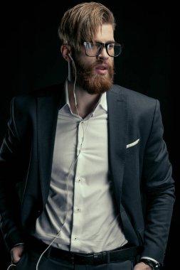 stylish man listening to music