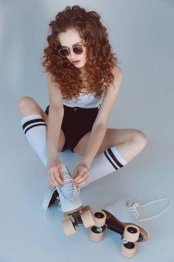 Hipster girl with roller skates