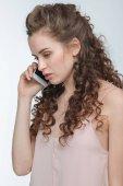 Fotografie Frau reden auf smartphone