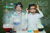 Photo kids in white coats in laboratory