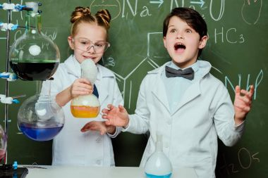 kids in white coats in laboratory