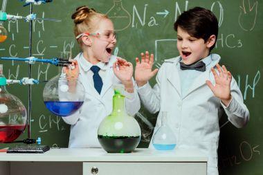 kids in white coats in laboratory