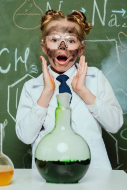 girl in lab coat with flask