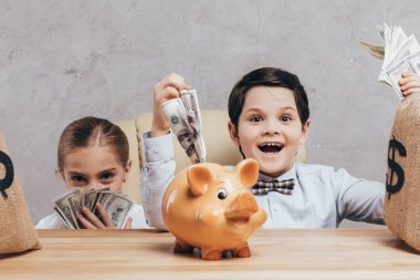 children at workplace with piggy bank