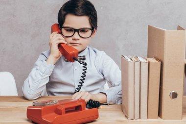 little boy talking on telephone