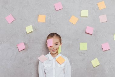child with stickers on face