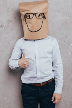 kid with paper bag on head
