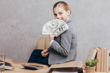 little kid holding money