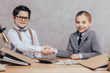 children shaking hands